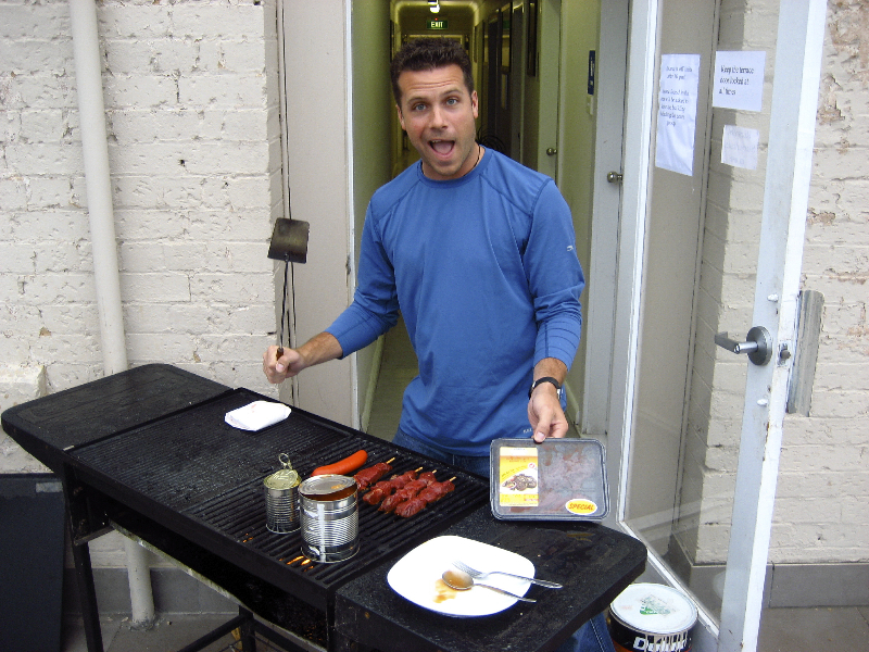 The grill master cooking up some local fare- kangaroo loin! Katoomba, Australia