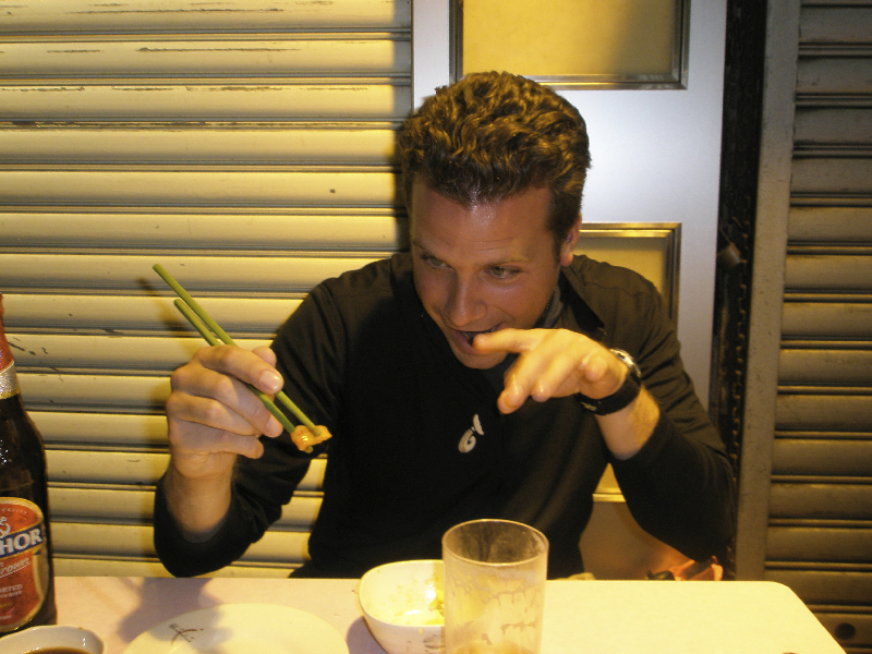 Honing my chopstick skills at the Temple Street Night Market- Hong Kong