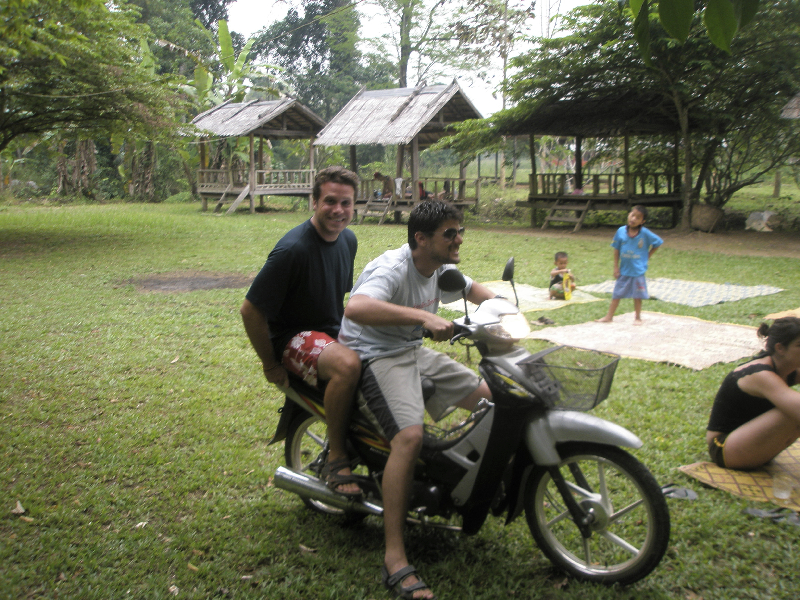 Motorbiking around Vang Vieng, Laos. Hang on!